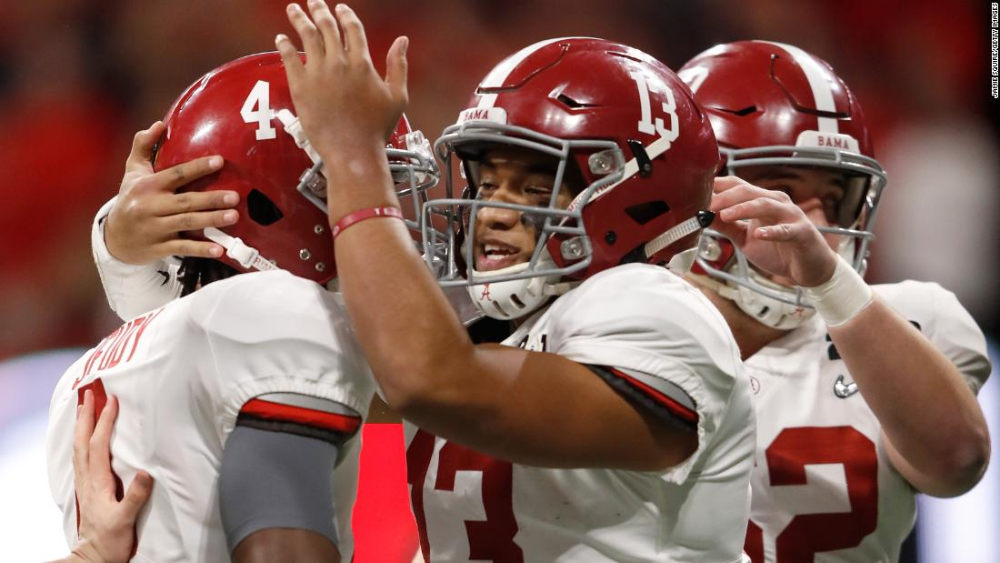 Tagovailoa (No. 13) celebrates with teammates after throwing a 6-yard touchdown pass early in the third quarter. Tagovailoa replaced Alabama starter Jalen Hurts after the Crimson Tide went scoreless in the first half.