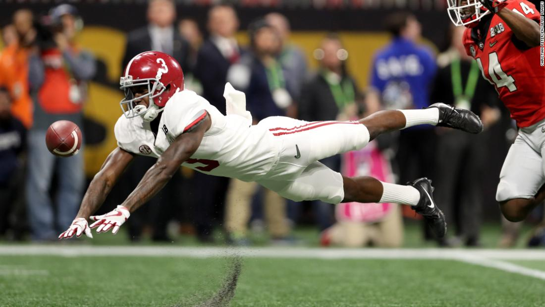 Alabama wide receiver Calvin Ridley dives for the ball but fails to pull in a third-quarter pass.