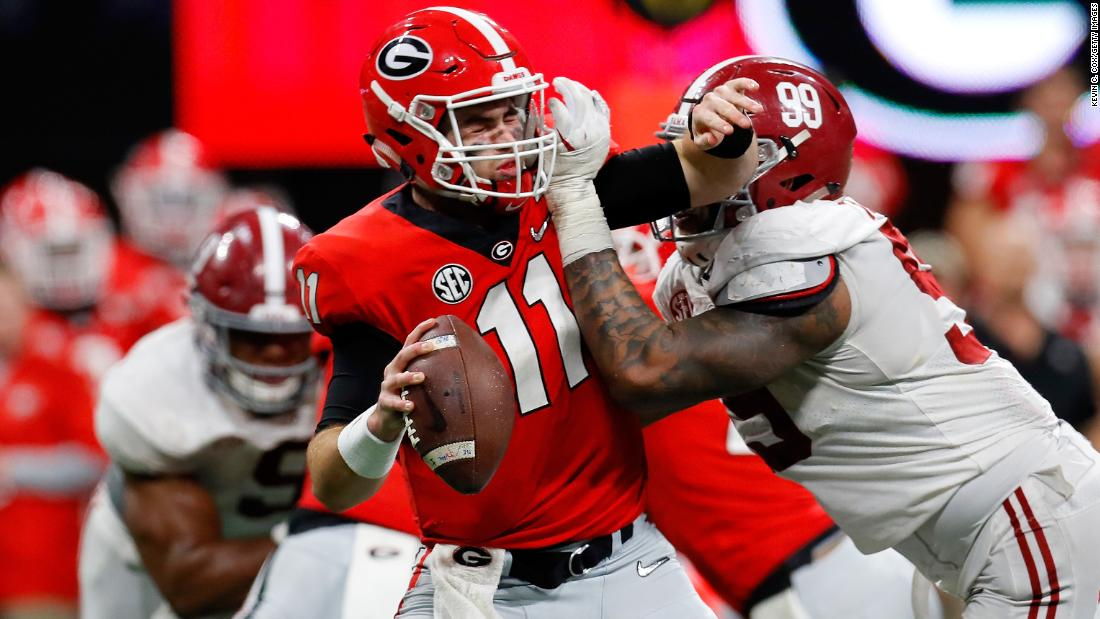Georgia quarterback Jake Fromm is sacked by Alabama's Raekwon Davis during the second half.