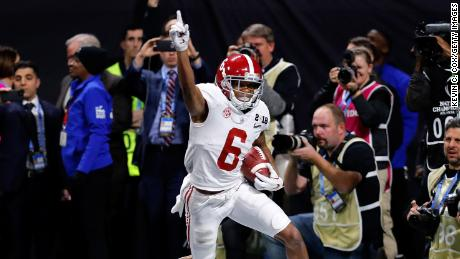 ATLANTA, GA - JANUARY 08:  DeVonta Smith #6 of the Alabama Crimson Tide celebrates catching a 41 yard touchdown pass to beat the Georgia Bulldogs in the CFP National Championship presented by AT&T in overtime at Mercedes-Benz Stadium on January 8, 2018 in Atlanta, Georgia.  (Photo by Kevin C. Cox/Getty Images)
