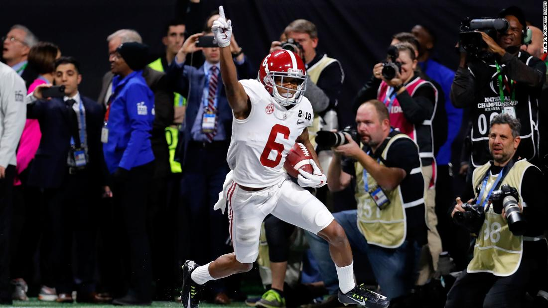 Alabama wide receiver DeVonta Smith celebrates after catching a 41-yard touchdown pass in overtime to beat Georgia 26-23 and win the national title on Monday, January 8. It is Alabama's fifth championship in the last nine years.