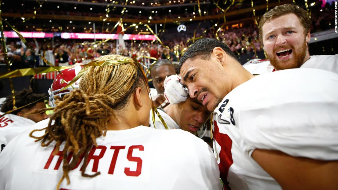 Alabama players hug after the victory. At center is Tua Tagovailoa, the freshman quarterback who came on at halftime and helped spark the team to a comeback victory. The Crimson Tide trailed 13-0 at halftime and 20-7 in the third quarter.