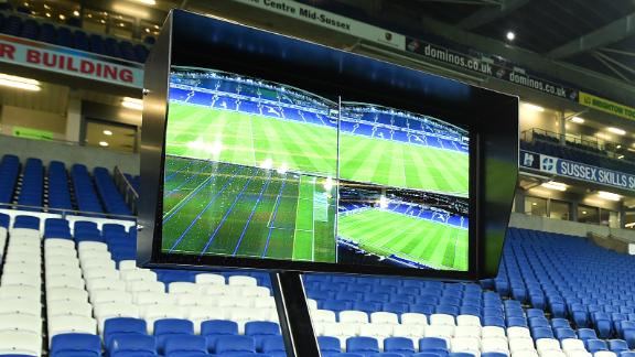 The Video Assistant Referee (VAR) system pitchside, is pictured prior to its use during the English FA Cup third round football match between Brighton and Hove Albion and Crystal Palace at the American Express Community Stadium in Brighton, southern England on January 8, 2018. / AFP PHOTO / Glyn KIRK / RESTRICTED TO EDITORIAL USE. No use with unauthorized audio, video, data, fixture lists, club/league logos or 'live' services. Online in-match use limited to 75 images, no video emulation. No use in betting, games or single club/league/player publications.  /         (Photo credit should read GLYN KIRK/AFP/Getty Images)