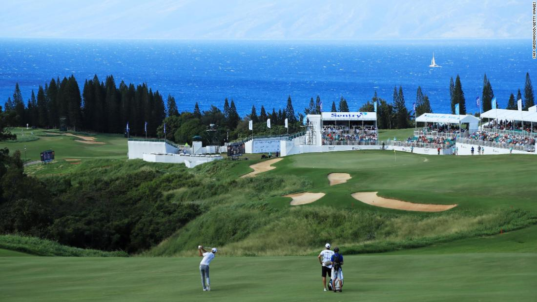 <strong>Into the blue: </strong>Dustin Johnson fires one towards the 18th green at Kapalua with the island of Moloka'i in the background. The powerful world No. 1 won the event by eight shots.
