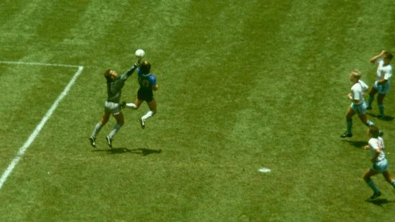 MEXICO CITY, MEXICO - JUNE 22: Argentina player Diego Maradona outjumps England goalkeeper Peter Shilton to score with his 'Hand of God' goal as England defenders Kenny Sansom (top) Gary Stevens (c) and Terry Fenwick look on during the 1986 FIFA World Cup Quarter Final at the Azteca Stadium on June 22, 1986 in Mexico City, Mexico.  (Photo by Allsport/Getty Images)