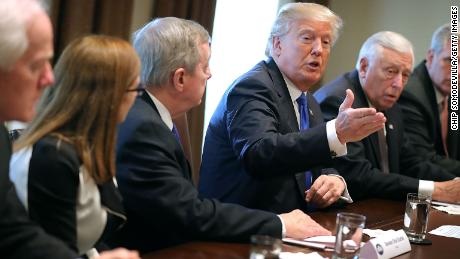 WASHINGTON, DC - JANUARY 09:  U.S. President Donald Trump (C) presides over a meeting about immigration with Republican and Democrat members of Congress, including (L-R) Senate Majority Whip John Cornyn (R-TX), Rep. Martha McSally (R-AZ), Senate Minority Whip Richard Durbin (D-IL), House Minority Whip Steny Hoyer (D-MD) and House Majority Leader Kevin McCarthy (R-CA) in the Cabinet Room at the White House January 9, 2018 in Washington, DC. In addition to seeking bipartisan solutions to immigration reform, Trump advocated for the reintroduction of earmarks as a way to break the legislative stalemate in Congress.  (Photo by Chip Somodevilla/Getty Images)
