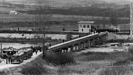 The USS Pueblo crew cross the Bridge of No Return between North and South Korea, after their release into US custody on December 23, 1968.