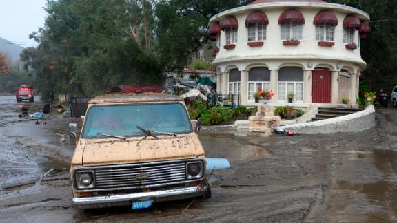 A van is stuck in the mud in the Sun Valley neighborhood of Los Angeles on January 9, 2018.