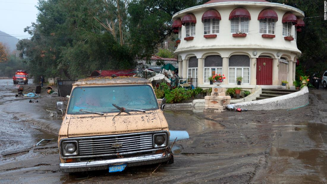 A van is stuck in the mud in the Sun Valley neighborhood of Los Angeles on January 9.