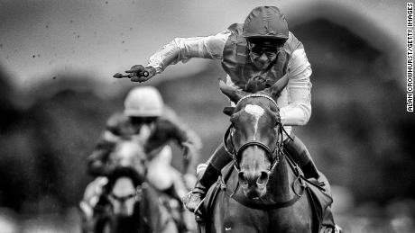 YORK, ENGLAND - AUGUST 24: (EDITORS NOTE: This image was processed using digital filters) Frankie Dettori riding Enable win The Darley Yorkshire Oaks at York racecourse on August 24, 2017 in York, England. (Photo by Alan Crowhurst/Getty Images)