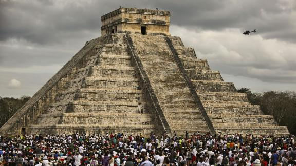 """Chichen itza, in Yucatan state, is one of the most impressive achievements of the ancient Mayan people. Pictured, thousands of tourists surround """"El Castillo"""" during a spring equinox celebration."""
