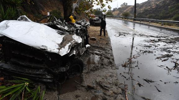 Mud fillled a Burbank street, destroyed two cars and damaged property.
