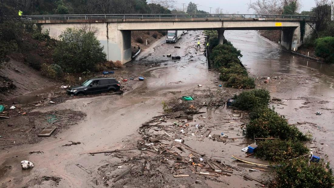 In this photo provided by Santa Barbara County Fire Department, US 101 at the Olive Mill Road overpass is flooded by Montecito Creek in Montecito, California, on January 9.