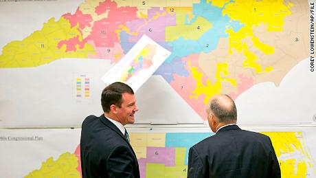 FILE-In this Tuesday, Feb. 16, 2016 file photo, State Senators Dan Soucek, left, and Brent Jackson, right, review historical maps during The Senate Redistricting Committee for the 2016 Extra Session in the Legislative Office Building at the N.C. General Assembly, in Raleigh, N.C. North Carolina found itself in the spotlight in 2016 over a number of issues including LGBT rights, voting rights, redistricting and most recently an unwillingness to hand over political power to a new Democratic governor. (Corey Lowenstein/The News & Observer, File via AP)