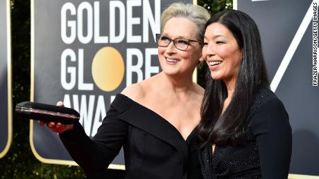 Labor activist Ai-jen Poo attends the Golden Globe Awards as a guest of Meryl Streep in 2018.