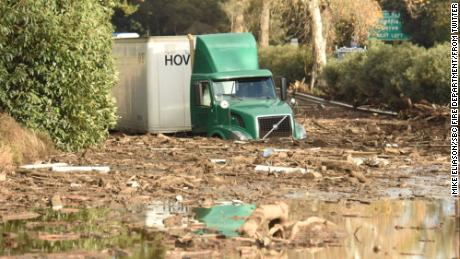 A semi-truck was stuck in mud on the 101 Freeway in Montecito.