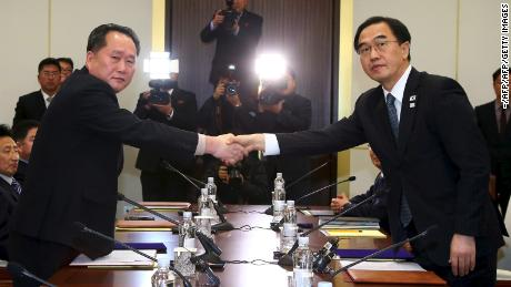 South Korea's Unification Minister Cho Myung-Gyun (R) shakes hands with North Korean chief delegate Ri Son-Gwon as they exchange joint statements during their meeting at the border truce village of Panmunjom in the Demilitarized Zone (DMZ) dividing the two Koreas on January 9, 2018. North Korea will send its athletes to the Winter Olympics in the South, the rivals said on January after their first formal talks in more than two years following high tensions over Pyongyang's nuclear weapons programme. / AFP PHOTO / KOREA POOL / - / South Korea OUT        (Photo credit should read -/AFP/Getty Images)