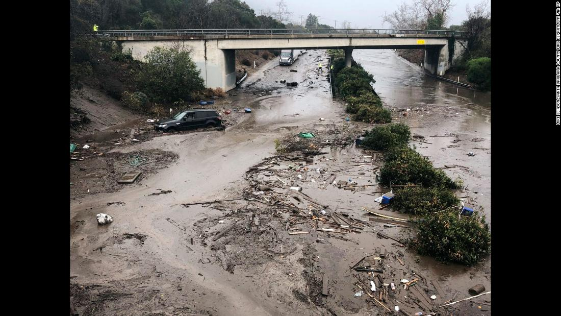 Runoff water from a creek floods Highway 101 in Montecito on January 9. Flooding forced many heavily traveled roads to close.