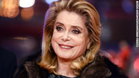 "(FILES) This file photo taken on February 14, 2017 shows French actress Catherine Deneuve posing on the red carpet for the premiere of the film ""Sage Femme"" (The Midwife) in competition at the 67th Berlinale film festival in Berlin.   France's most revered actress Catherine Deneuve hit out on January 9, 2018 at a new ""puritanism"" sparked by sexual harassment scandals, declaring that men should be ""free to hit on"" women. / AFP PHOTO / dpa / Gregor Fischer / Germany OUTGREGOR FISCHER/AFP/Getty Images"