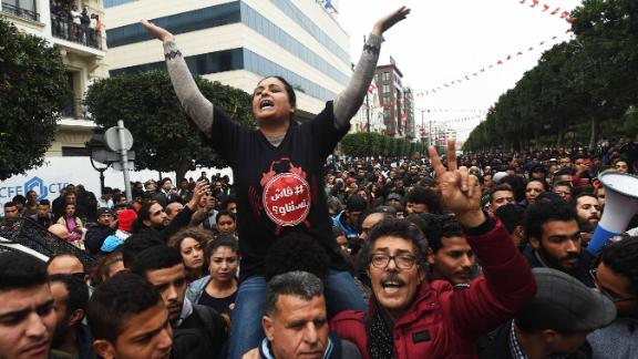 TOPSHOT - Tunisians shout slogans during a demonstration against the government and price hikes on January 9, 2018 in Tunis.Protests hit several parts of Tunisia where dozens of people were arrested and one man died in unclear circumstances amid anger over rising prices, authorities said. / AFP PHOTO / FETHI BELAID        (Photo credit should read FETHI BELAID/AFP/Getty Images)
