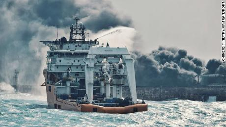 A Japanese vessel tries to extinguish the flames on the Sanchi on Wednesday.