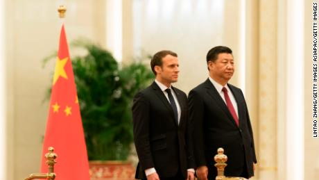 Chinese President Xi Jinping invites French President Emmanuel Macron to view an honour guard during a welcoming ceremony inside the Great Hall of the People on January 9, 2018.