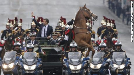 A horse rears during French President Emmanuel Macron's inauguration ceremony. Macron gifted his Chinese counterpart Xi Jinping a horse during his visit to China.