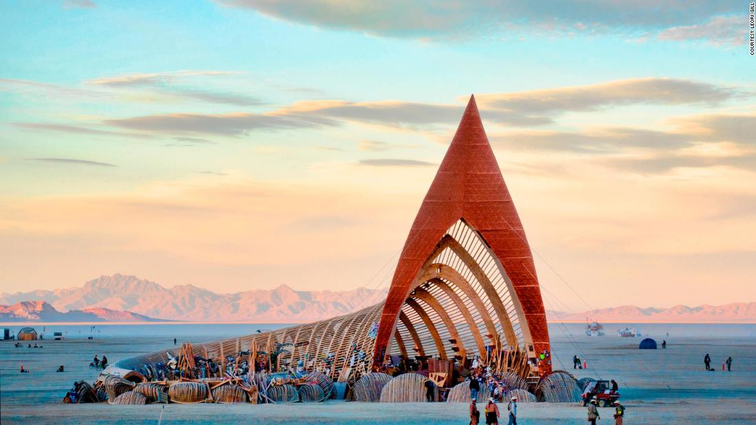 Designed by Jazz Tigan, the lobed spire at the opening of 2015's Temple of Promise was 97-feet high, while the tail of the building curled inwards around an open-air grove with bare trees.