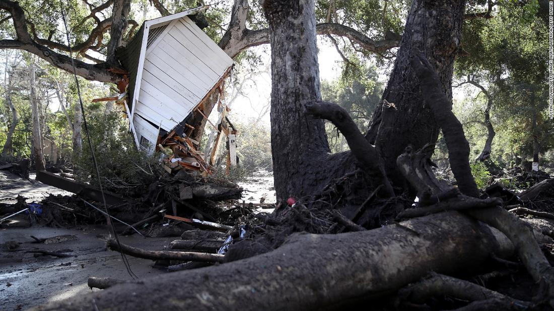 Part of a structure sits in a tree after being knocked off its foundation by a Montecito mudslide on January 10.