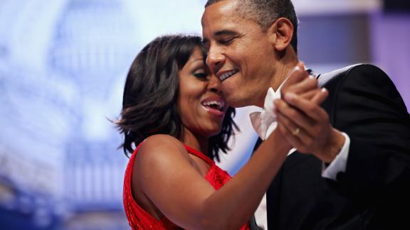 WASHINGTON, DC - JANUARY 21:  U.S. President Barack Obama and first lady Michelle Obama sing together as they dance during the Inaugural Ball at the Walter Washington Convention Center January 21, 2013 in Washington, DC. Obama was sworn-in for his second term of office earlier in the day.  (Photo by Chip Somodevilla/Getty Images)