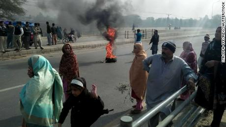 People burn tyres during a protest in Kasur on Wednesday against the murder and rape of Zainab.