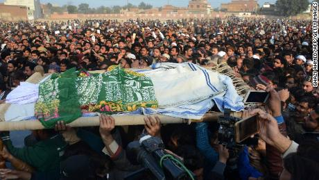 Pakistani residents carry the body of a girl during her funeral in Kasur in Punjab Province on January 10, 2018, following her rape and murder. 