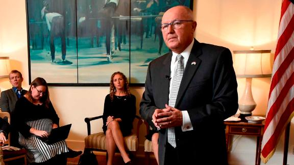 US Ambassador to The Netherlands, Peter Hoekstra (R) gestures as he speaks during a press conference at the US embassy, in The Hague, on January 10, 2018 after presenting his diplomatic credentials to The Netherlands' King.  / AFP PHOTO / JOHN THYS        (Photo credit should read JOHN THYS/AFP/Getty Images)
