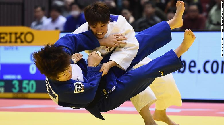 Judoka Ruika Sato (white) and Mami Umeki (blue) battle it out in December before the rule changes.