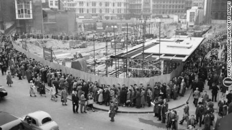 People queue to see the remains of the temple in 1954.
