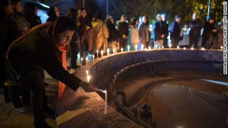 Pakistani civil society activists hold a vigil in tribute to Zainab, who was raped and murdered in the city of Kasur in Punjab province, in Islamabad on January 11, 2018.   Hundreds of protesters enraged over the murder of the young girl threw stones at government buildings in a Pakistani city near the Indian border for a second day on January 11, amid growing outrage over the killing. The child, named as Zainab, is the eighth minor to have been raped and murdered in Kasur in the past 12 months, police have said. / AFP PHOTO / AAMIR QURESHIAAMIR QURESHI/AFP/Getty Images