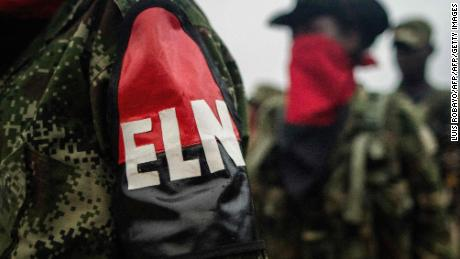 "(FILES) This file photo taken on November 19, 2017 shows members of the ""Omar Gomez"" Western War Front of the National Liberation Army (ELN) guerrilla lining up in their camp on the banks of the San Juan River, Choco department, Colombia. The ELN  warned on December 4, 2017 that the continuity of the ceasefire agreed with the Colombian government is ""at risk"", following ""serious events"" that have occurred since it entered into force on October 1st. / AFP PHOTO / LUIS ROBAYO / TO GO WITH AFP STORYLUIS ROBAYO/AFP/Getty Images"