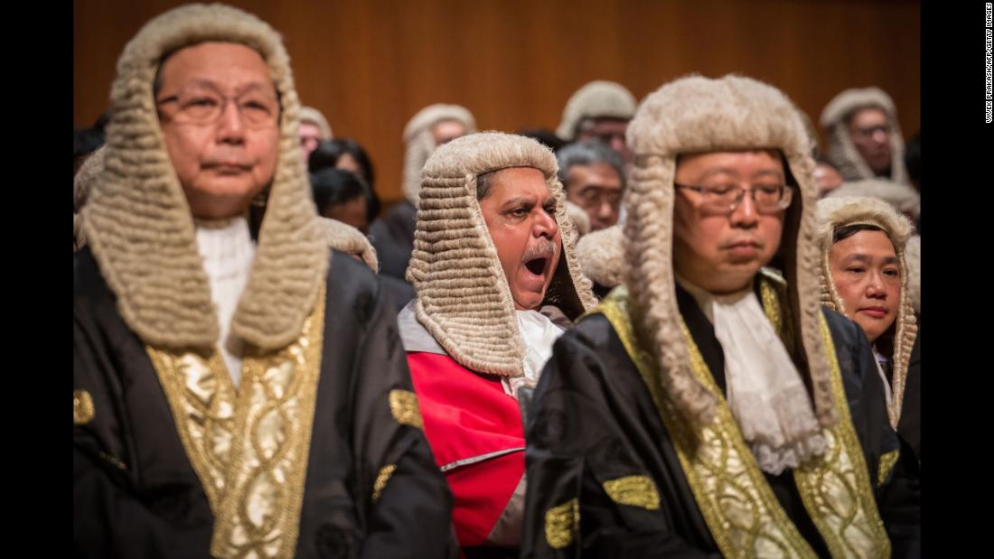 A judge yawns during a ceremony held to mark the opening of the legal year in Hong Kong on Monday, January 8.