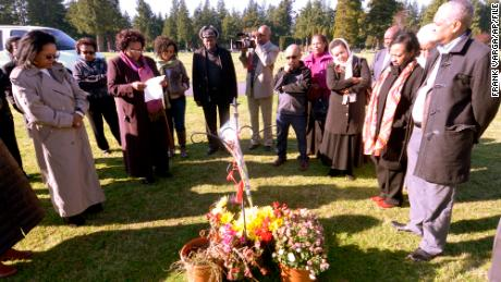 Members of Seattle's Ethiopian community gather around the grave of Hana Williams on October 29, 2013, a few hours after the sentencing of Larry and Carri Williams.