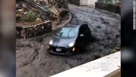 Video shows couple fleeing mudslide in car