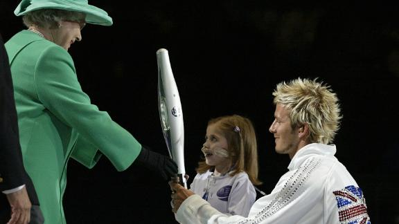 She was on hand to open the 2002 Games along with former England football captain David Beckham.
