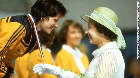BRISBANE, AUSTRALIA - 1982:  Tracey Wickham of Australia recieves her gold medal from Queen Elisabeth during the 1982 Commonwealth Games held in Brisbane, Australia. (Photo by Tony Feder/Getty Images)