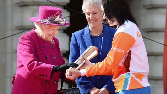 While not in attendance, her speech will be delivered from a written note inside the Queen's Baton Relay, which has traveled throughout the Commonwealth before the Games.