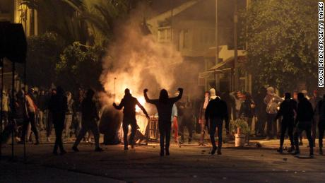 TOPSHOT - Tunisian protesters take to the streets in Siliana, some 130 kms south of Tunis, late on January 11, 2018. 