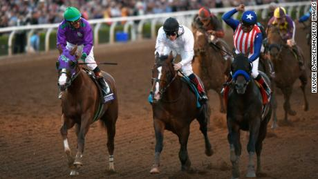 Toast of New York (center) finishes a nose behind winner Bayern (right) with California Chrome (left) third in the 2014 Breeders' Cup Classic.