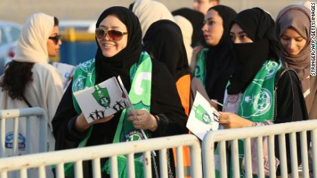 Female Saudi supporters of Al-Ahli queue at an entrance for families and women at the King Abdullah Sports City in Jeddah on January 12, 2018, ahead of their teams football match against Al-Batin in the Saudi Pro League.