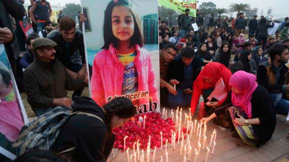 Pakistani students light candles during a protest rally in Lahore on Thursday over the rape and killing of Zainab in Kasur.