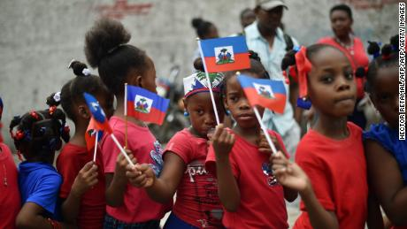 A group of students from the school Coeur Immaculé de Marie take part in a small parade organized for Haitian Flag Day in the center of the Haitian Capital Port-au-Prince on May 18, 2017.