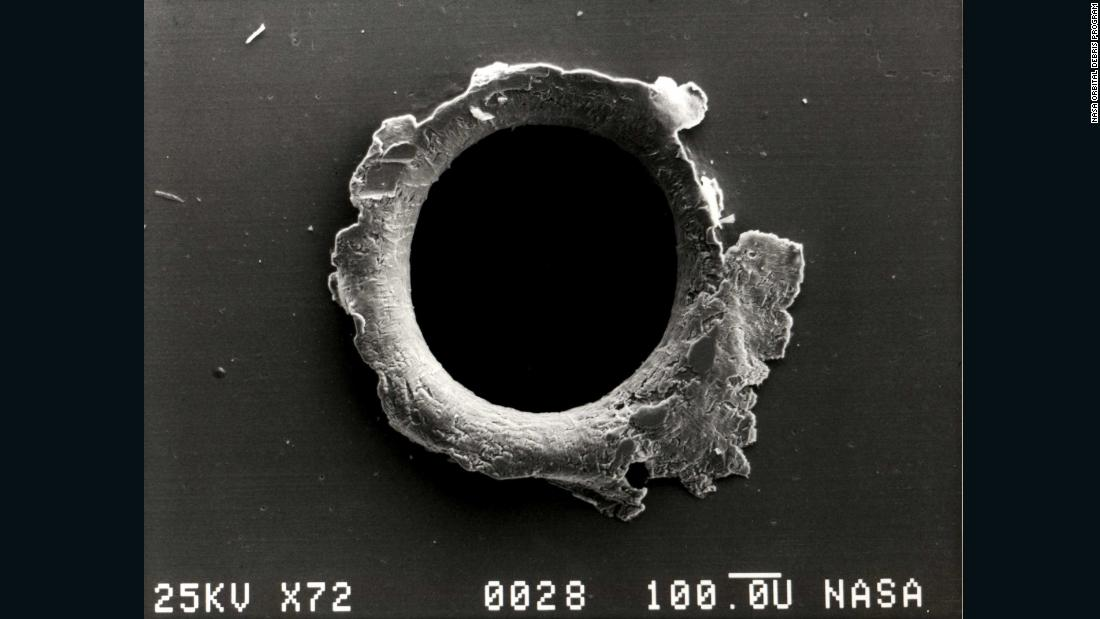A close-up photograph showing the damage sustained by the Solar MAX experiment from a tiny piece of space debris. Today the International Space Station has a number of debris protocols, from maneuvering out of a collision path to sheltering in a Soyuz capsule when the probability of a significant collision is high.