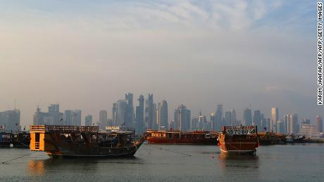 A general view taken on September 24, 2017 shows boats moored in front of the skyline of the Qatari capital, Doha. / AFP PHOTO / KARIM JAAFAR        (Photo credit should read KARIM JAAFAR/AFP/Getty Images)